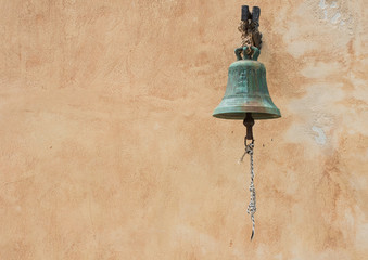 church bell and wall on background