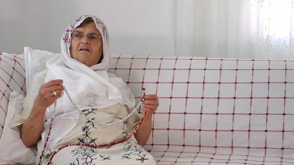 Old Woman Prays with Rosary