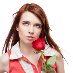 attractive thoughtful girl holding red rose