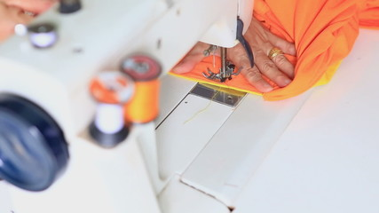 Labor working with sewing machine