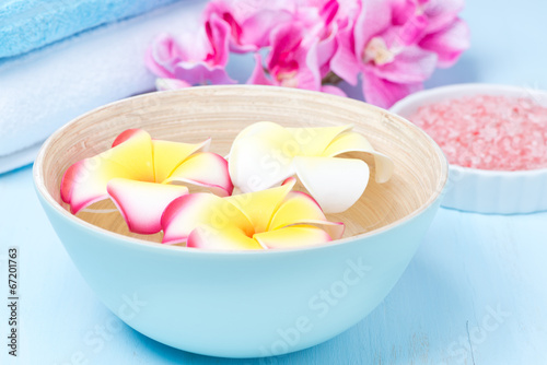 flowers in a blue bowl, towels and sea salt