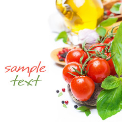 fresh cherry tomatoes, basil and spices, isolated