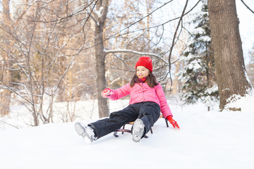 small girl sliding from hill fast.