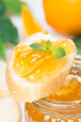 piece of baguette with orange marmalade