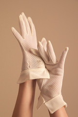 woman modeling vintage formal white mesh gloves