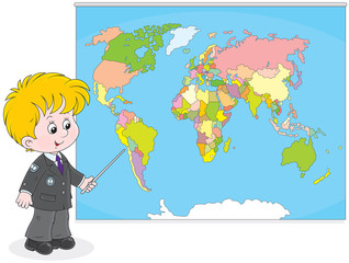 Schoolboy at a map of World