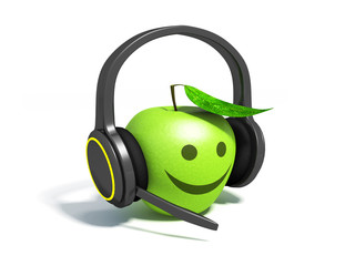 Green apple with leaf on headphones