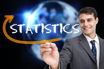 Businessman writing the word statistics