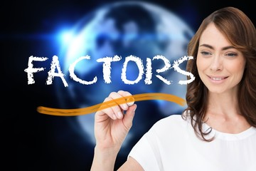Businesswoman writing the word factors