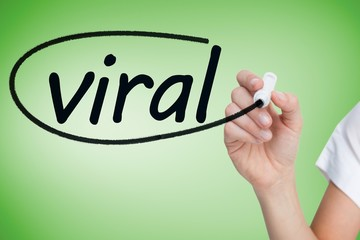 Businesswoman writing the word viral