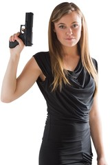 Femme fatale pointing gun up