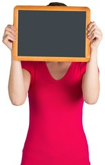 Woman covering face with chalkboard