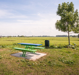 Modern picnic table and benches in a rural area