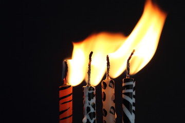 Animal print candles with the flame being blown