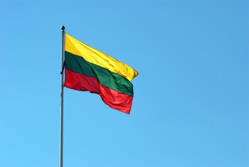 Lithuania flag in the sky waving on the wind