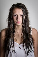 Water Streams Down Teenage Girl's Face