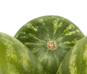 Three whole ripe watermelons, close up, isolated on white