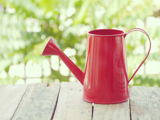 Red watering can retro vintage style