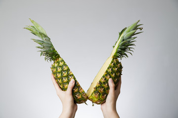 Pineapple in female hands