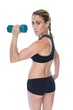 Female bodybuilder holding a blue dumbbell looking at camera