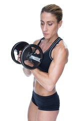 Female strong bodybuilder holding large black dumbbell