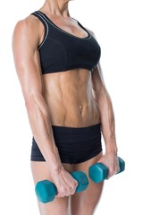 Female bodybuilder holding two dumbbells with arms down