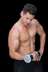 Focused crossfitter lifting up heavy dumbbell