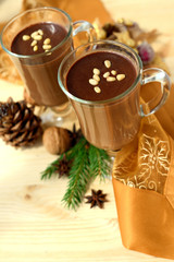 Hot chocolate decorated with pine nuts.