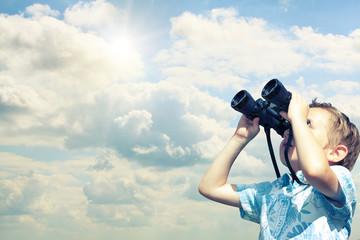 boy searching with binoculars