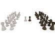 Wooden chess pieces facing off