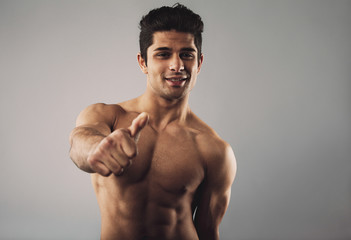Shirtless young hispanic man wishing you good luck