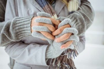 Cute couple in warm clothing holding hands