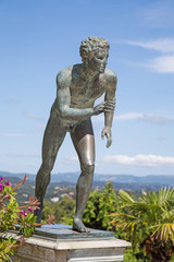 A statue of 'The Runner' in the garden of Achilleion in Corfu.