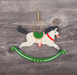 Christmas decorative ornament - Horse ornament on wooden backgro