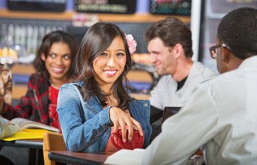 Smiling Young Woman in Cafe