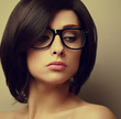 Beautiful woman with black hair in glasses. Closeup vintage