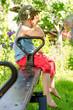 Little boy sulking as he sits on a seesaw