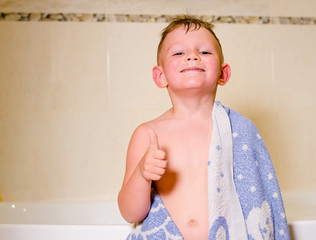 Mischievous little boy in his bath