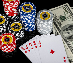 Poker chips Playing cards and dollars