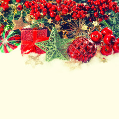 christmas decoration with baubles, golden garlands and red berri