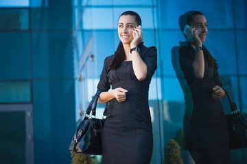 Successful businesswoman talking on cellphone.
