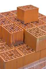 Stacked orange hollow clay block for building construction
