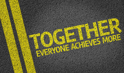 Together Everyone Achieves More written on the road