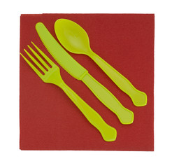 Bright green yellow disposable plastic cutlery, knife fork and s