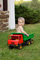 Boy sitting in a truck.