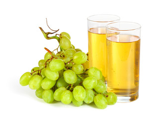 Grape bunch and glasses of juice isolated on white