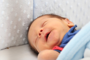 Newborn smiling in his dream