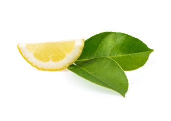Fresh sliced lemon and leaf isolated on white.