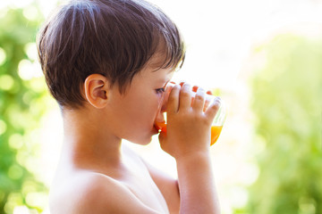 Little boy drink juice