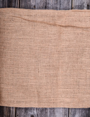 Worn sack on wood background